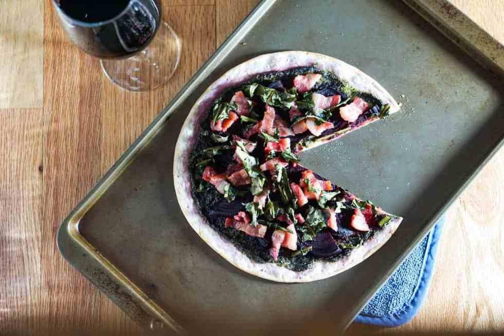 The healthiest pizza on earth. This gluten free, dairy free Beet and Dandelion Flatbread Recipe is chocked full of detoxing nutrients. Perfect spring meal.