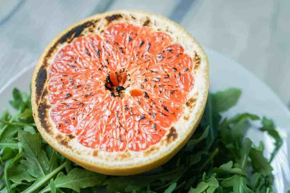 This brûléed grapefruit recipe showcases caramelized sugars without added refined sugars and cream. Add tossed arugula for a paleo, whole 30, GF, DF lunch.