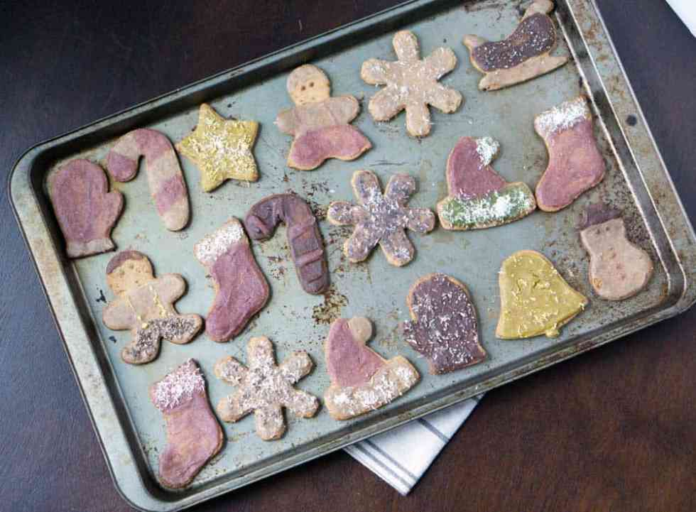 All natural Vintage looking cut out cookies made with 2 ingredient healthy blender frosting and naturally colored with beet, turmeric, spinach, blueberry and cocoa.