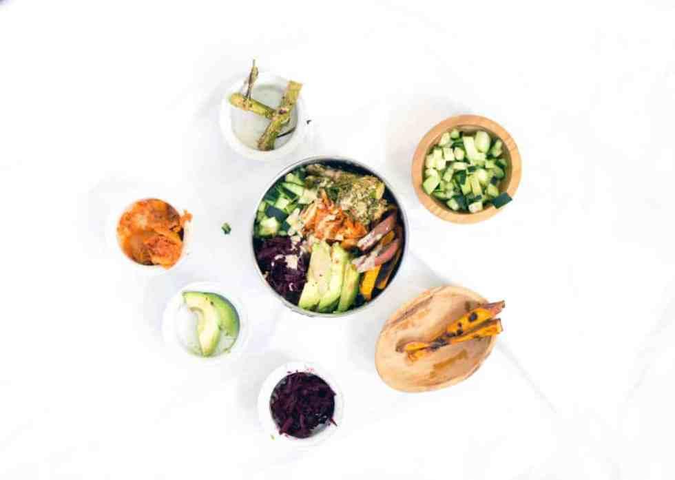 Sweet potatoes, cucumbers, beets, Kimchi, tahini brocolini, avocado on tahini massaged Kale