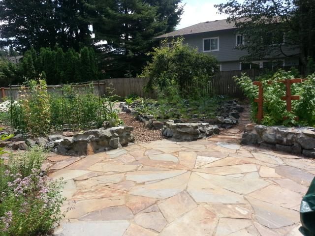 Cicular Flagstone Patio With Raised Garden Beds Cascadia