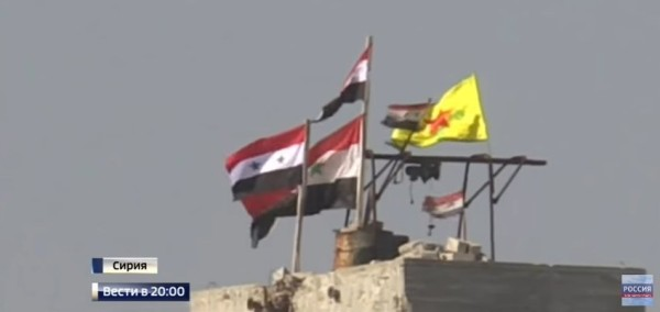 Kurdish and Assad regime flags flying together in Aleppo