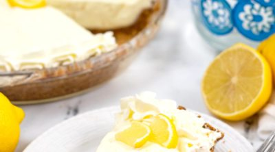 Close up image of a slice of sugar free lemon pie decorated with a slice of lemon