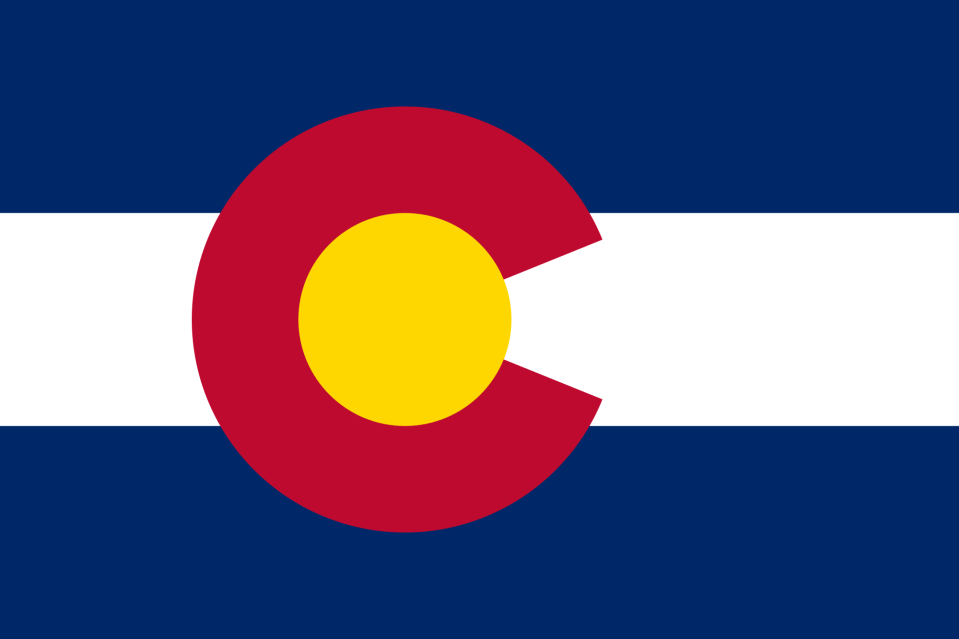 Colorado state flag with 3 horizontal stripes of blue, white, and blue and a red letter, C, filled with a gold circle.