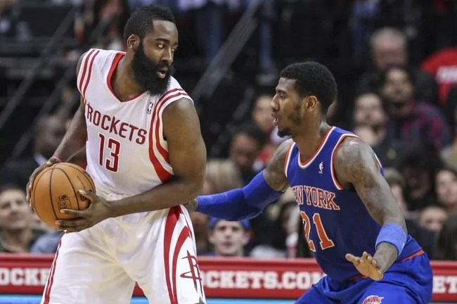 Jan 3, 2014; Houston, TX, USA; Houston Rockets shooting guard James Harden (13) controls the ball during the third quarter as New York Knicks shooting guard Iman Shumpert (21) defends at Toyota Center. The Rockets defeated the Knicks 102-100. Mandatory Credit: Troy Taormina-USA TODAY Sports