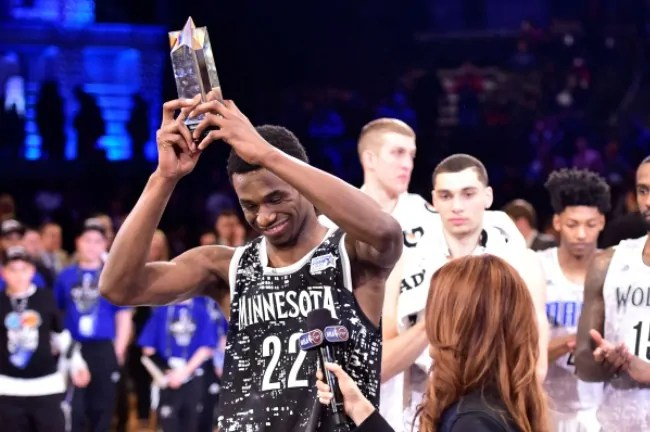 Feb 13, 2015; New York, NY, USA; World Team guard Andrew Wiggins of the Minnesota Timberwolves (22) hoists the MVP trophy after the game against the U.S. Team at Barclays Center. Mandatory Credit: Bob Donnan-USA TODAY Sports