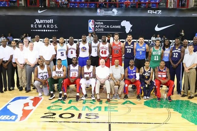 JOHANNESBURG, SA - AUGUST 1: Head Coach Lionel Hollins and Assistant Coach Brad Stevens of Team World with players Chris Paul #3, Bradley Beal #3, Trey Burke #3, Kenneth Faried #35, Marc Gasol #33, Pau Gasol #16, Jeff Green #32, Evan Turner #11, and Nikola Vucevic #9 of Team World with Head Coach Gregg Popovich and Assistant Coaches Mike Budenholzer and Monty Williams of Team Africa with players  Luol Deng #9, Al-Farouq Aminu #8, Giannis Antetokounmpo #34, Nicolas Batum #5, Bismack Biyombo #8, Boris Diaw #33, Gorgui Dieng #5, Festus Ezeli #31, Serge Ibaka #9, and Luc Mbah a Moute #12 of Team Africa prior to the NBA Africa Game 2015 as part of Basketball Without Borders on August 1, 2015 at the Ellis Park Arena in Johannesburg, South Africa.  NOTE TO USER: User expressly acknowledges and agrees that, by downloading and or using this photograph, User is consenting to the terms and conditions of the Getty Images License Agreement. Mandatory Copyright Notice: Copyright 2015 NBAE  (Photo by Nathaniel S. Butler/NBAE via Getty Images)