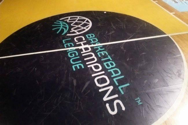 nick-galis-hall-aris-champions-league-logo
