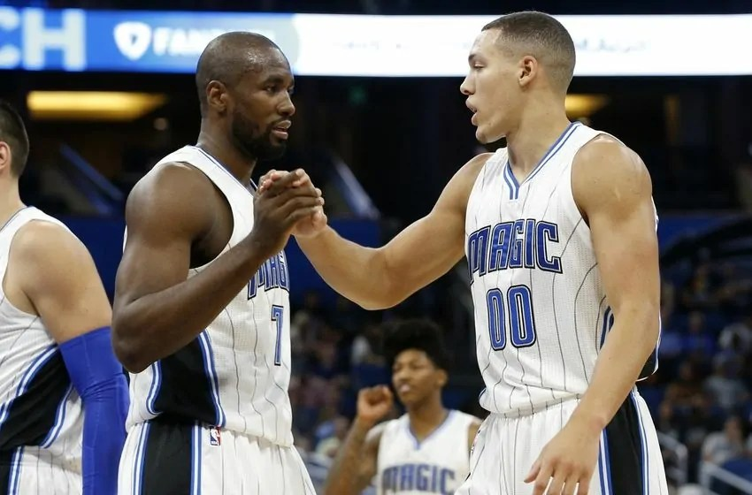 Oct 12, 2016; Orlando, FL, USA; Orlando Magic forward Serge Ibaka (7) and Orlando Magic forward Aaron Gordon (00) talk against the San Antonio Spurs during the first quarter at Amway Center. Mandatory Credit: Kim Klement-USA TODAY Sports