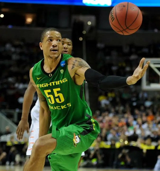 Tony Woods attempts to reign in the ball during Oregon's 68-55 victory over Oklahoma State in the second round of the 2013 NCAA Basketball Championship at HP Pavilion March 21, 2013. (Alex McDougall/Emerald)