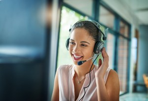 Shot of a young woman working in a call center