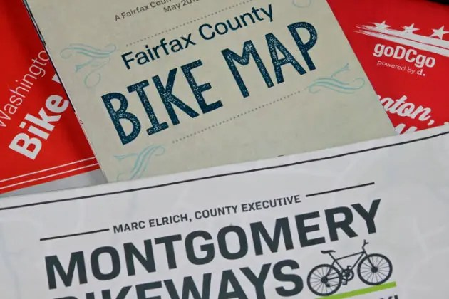 A pile of biking maps from Washington DC, Montgomery County and faifax county - ebike lovers