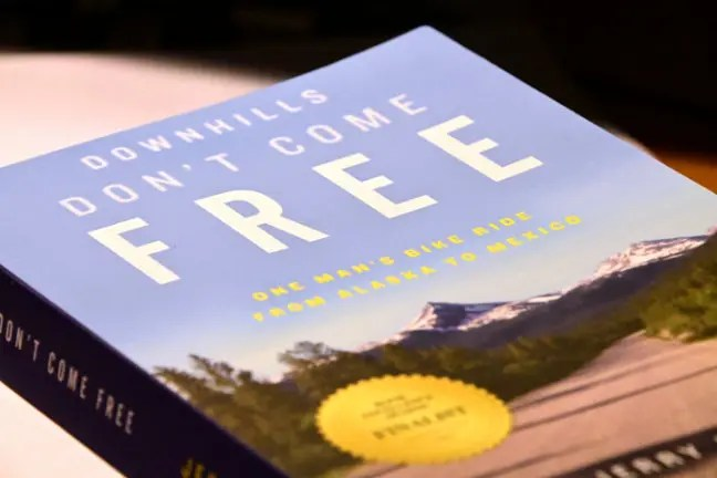 Cover of book Downhills Don't Come Free: One Man's Bike Ride from Alaska to Mexico