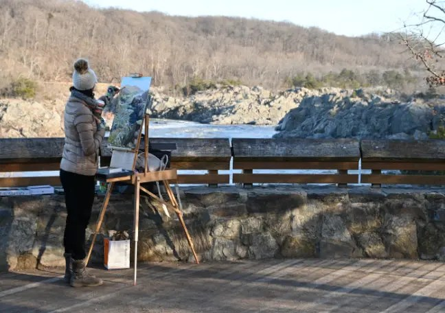 An artist painting the Mather Gorge at an overlook