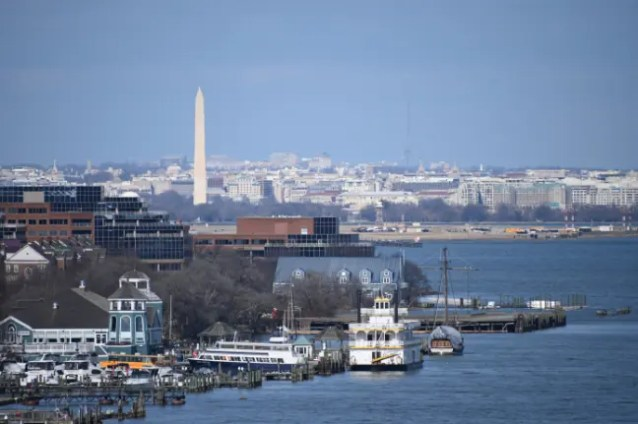 Old town Alexandria seen from the Woodrow Wilson Bridge with the National Monument in the background