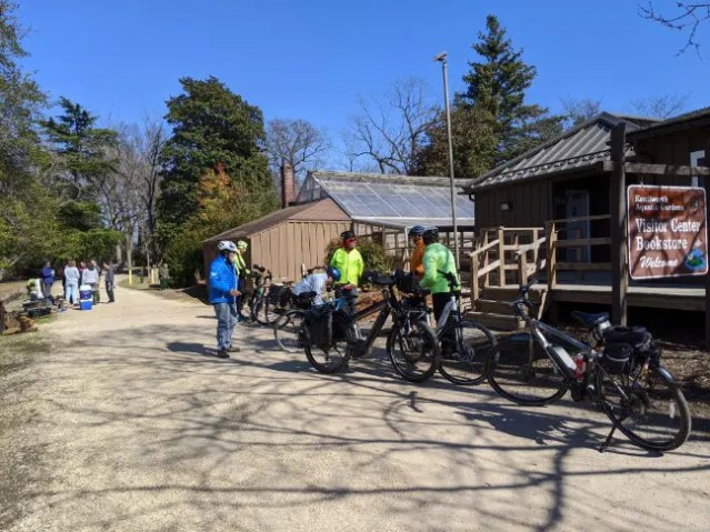 E-bikers in front of the Visitors Center of the Kenilsworth Aquatic Gardens