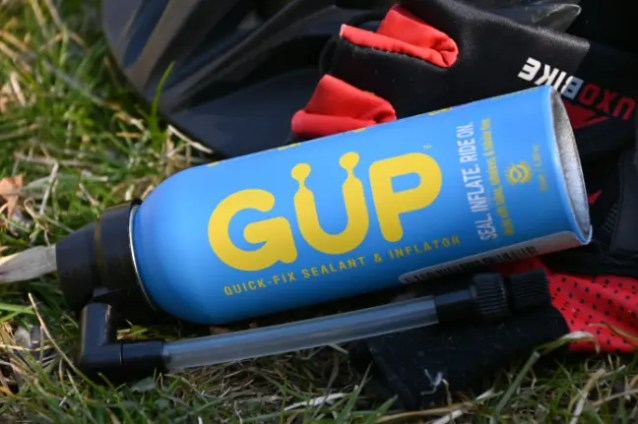 A canister of tire sealant and CO2 Kwiki Inflator & Sealant (GUP Kwiki) by GUP Industries