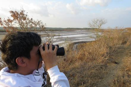 Gerard Khonghun watching the birds on the salt fields