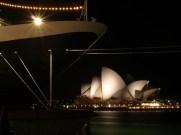 "huge cruise ship like a side on sky scraper called ""Amsterdam"", and the Opera House"
