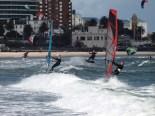 kitesurfers and windsurfers share the waves