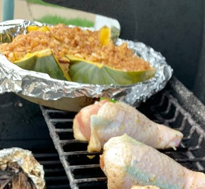 Grilling chicken and stuffed acorn squash