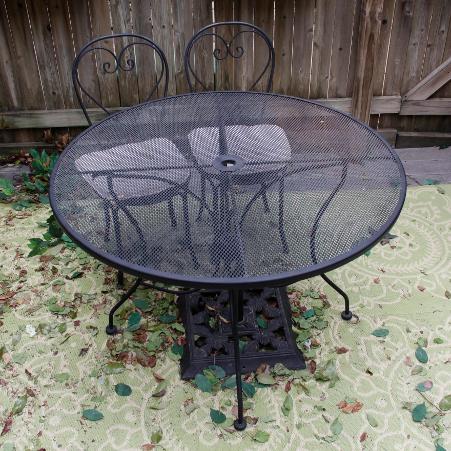 round plantation patterns metal mesh patio table and two chairs