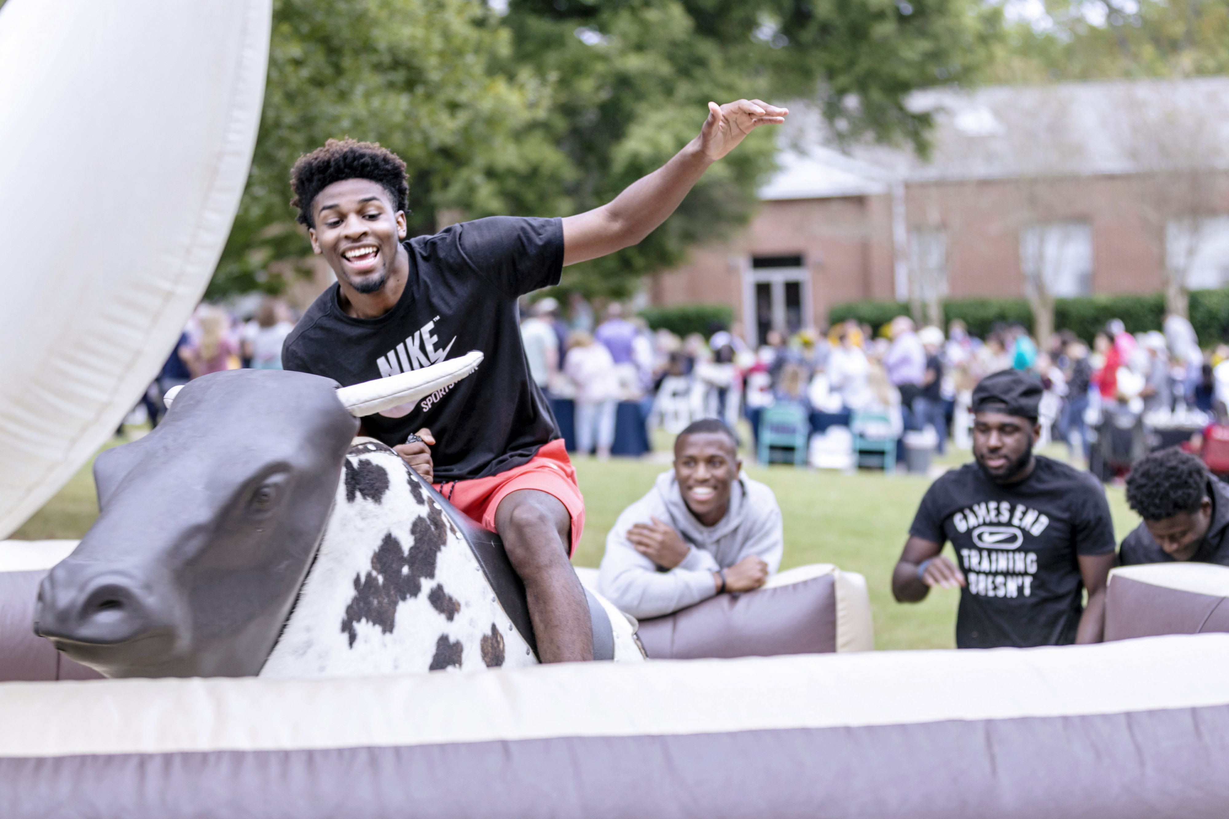 Student riding mechanical bull