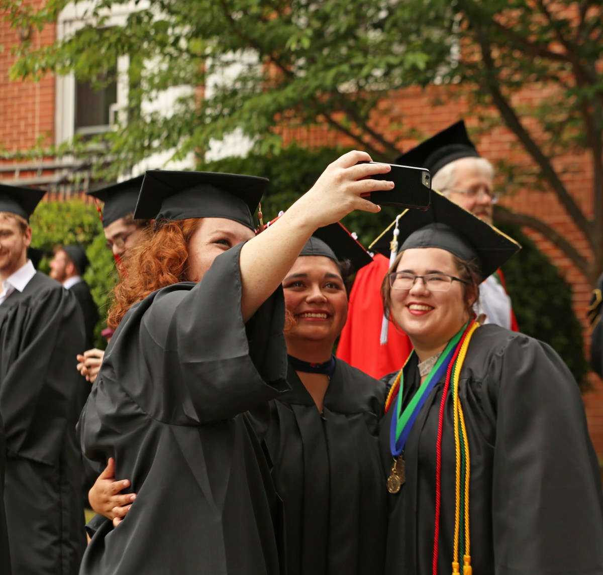 Female graduates taking selfies