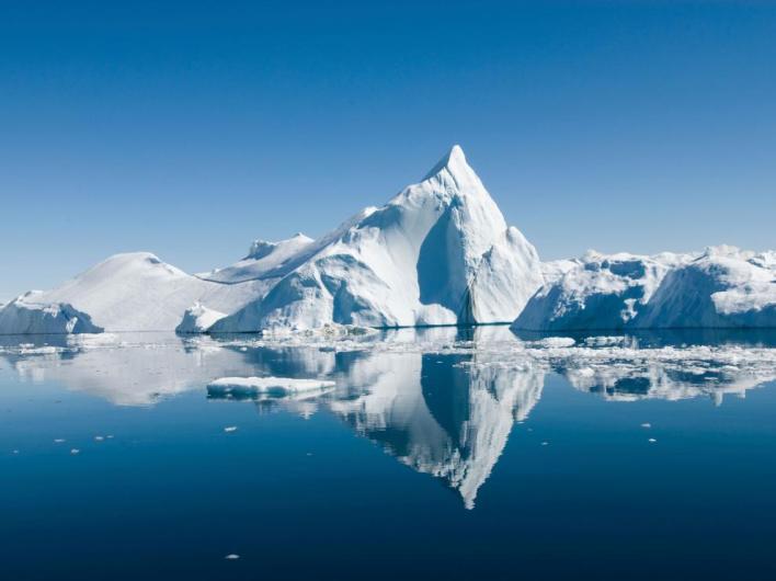 Icebergs drift in calm seas off the Greenland coast. @Imagebear / iStock