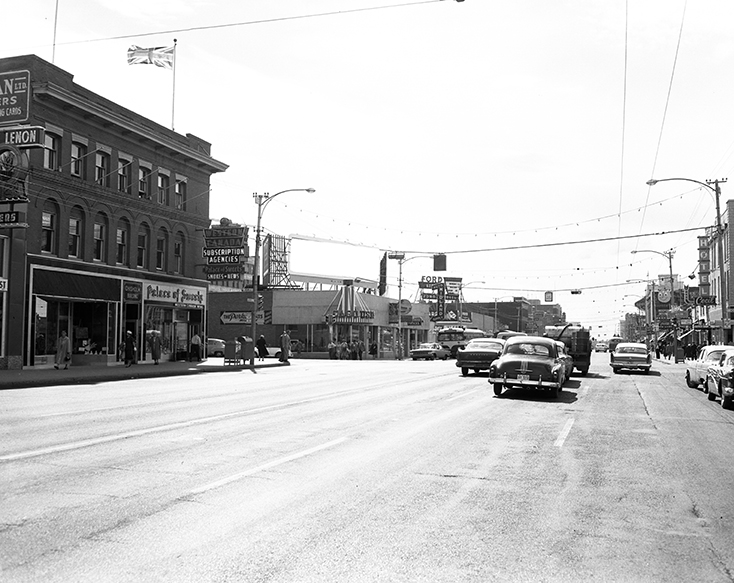 Jasper Avenue - 104 Street (west) circa 1956. The Palace of Sweets is visible to the left at the far corner of the first brick building (the Chisholm Block). Image courtesy of the City of Edmonton Archives.