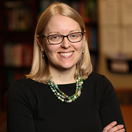 A headshot of Katie Linder, director of the OSU Ecampus Research Unit. She wears a simple black blouse and black-rimmed glasses.