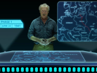 An instructor stands behind a sci-fi projection table