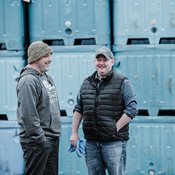 Tommy Sheridan and Chris Golatto talk outside of a crabbing facility