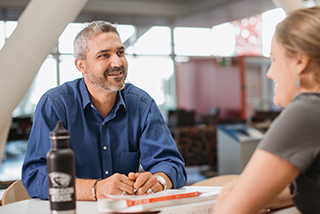Eric Vela says the ability to easily interact with classmates and faculty is a primary benefit of the hybrid MBA in Organizational Leadership track.