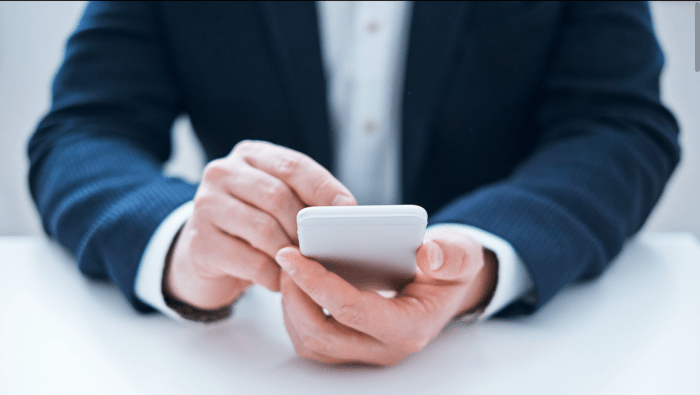 This picture depicts a gentleman sending an email on his smartphone. The caption is the Mailto: email address information for eCareerCoaching.com.