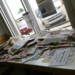 Flyers stack up at Coronation's post office.