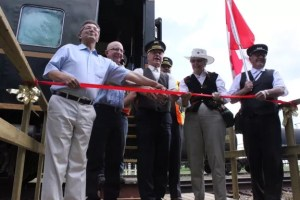 (L - R) Reeve of the County of Flagstaff, Gerald Kuefler, Deputy Mayor of Forestburg, Peter Miller, Chairman of the Board of Directors of the Battle River Railway, Ken Eshpeter, Mayor of Alliance and Chairman of the Board of Directors of the Friends of the Battle River Railway, Muriel Fankhanel and Jon Oberg helped cut the ribbon July 7 at the inaugural celebrations of the Friends of the Battle River Railway tourism project.
