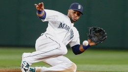 SEATTLE, WA - JULY 27: Second baseman Robinson Cano #22 of the Seattle Mariners fields a grounder off the bat of Aaron Hill to end the top of the seventh inning against the Arizona Diamondbacks at Safeco Field on July 27, 2015 in Seattle, Washington. (Photo by Otto Greule Jr/Getty Images)