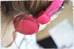 Picture of girl wearing pink headphones
