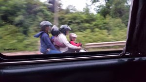 4 people on a scooter
