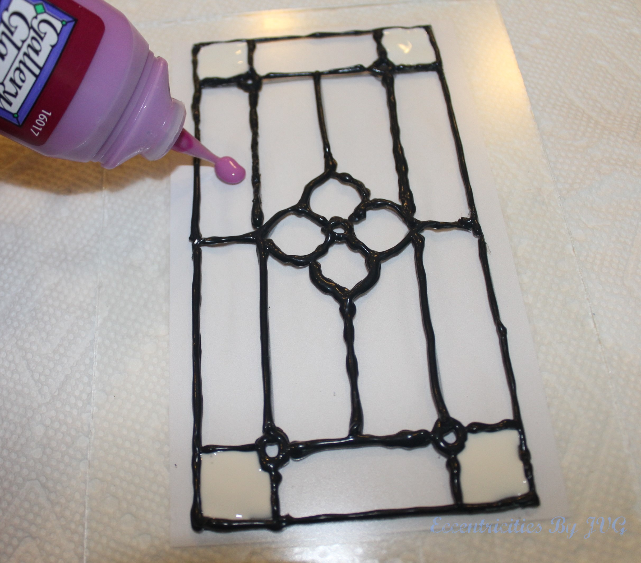 apply the glass paint to the stained glass art