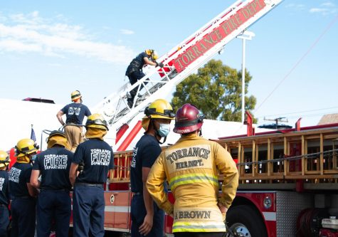 Each Torrance fire recruit must be tested on climbing the fire engine ladder. Engine ladders are  essential to reach high areas and roofs in a fire. Adam Brown observes and assesses their performance.