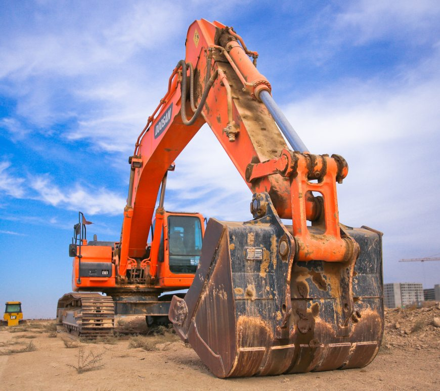Orange Excavator in the beach
