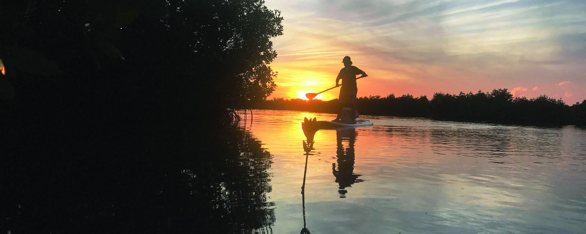 Sunset paddle board fishing