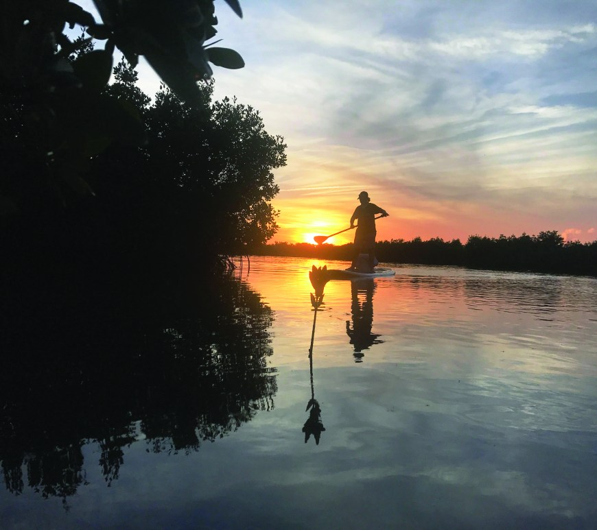 Sunset paddle board fishing