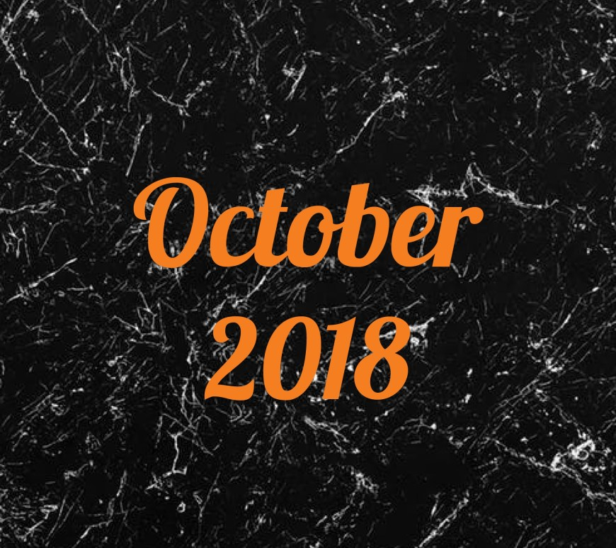 October 2018 in orange text on black and white marble background