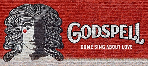 godspell logo on brick wall
