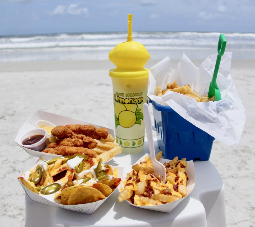 table of food and snacks on beach