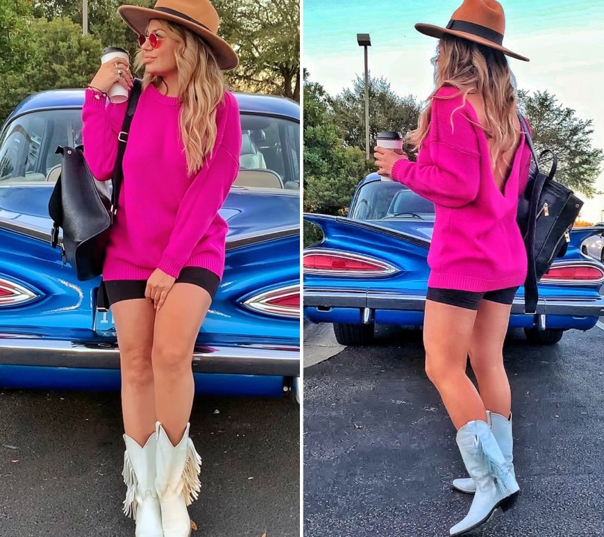 woman in pink sweater, hat and fringed ankle boots leans against car