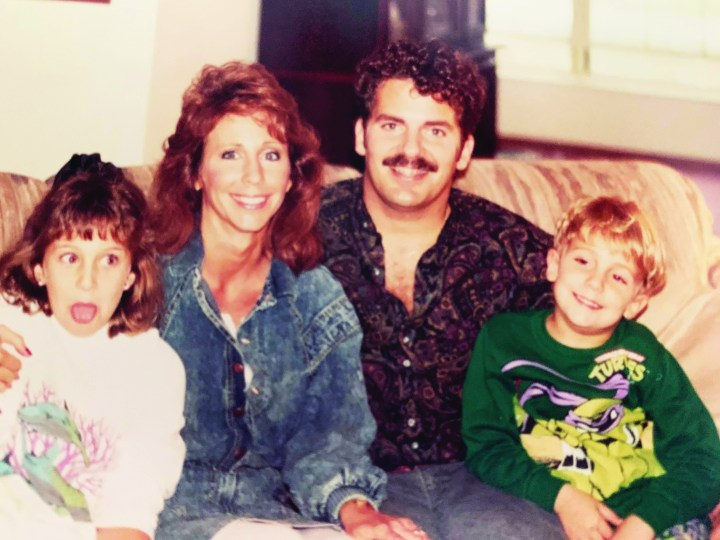family of four in the 1990s sitting on couch
